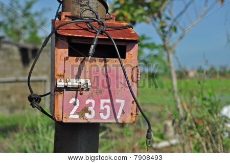 rusty letter box in the urban countryside