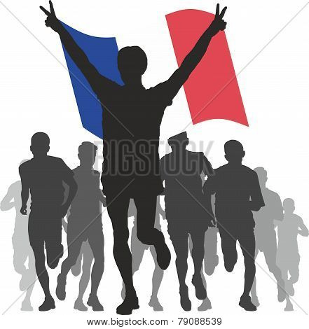 Winner with the France flag at the finish