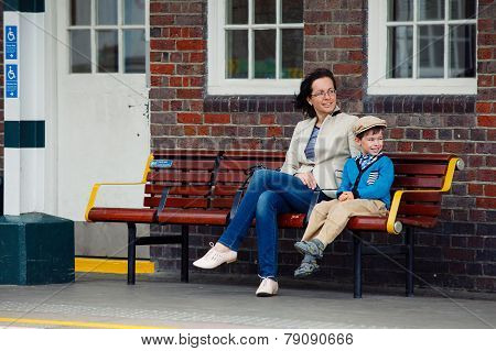 Young mother and son on railway station platform