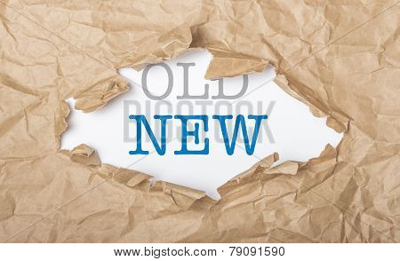New And Old Words On Paper And Torn Cardbox