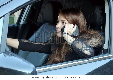 young adult woman driving in violation