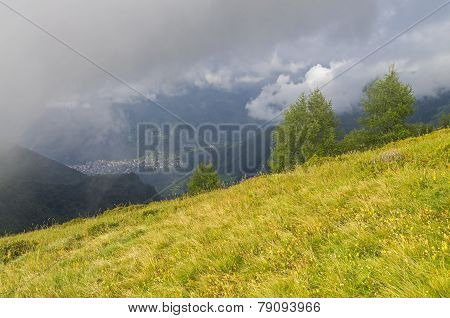 Clouds On The Mountain Slopes. Alps, Italy.