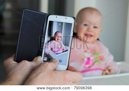 Taking A Picture Of A Baby With A Mobile Phone
