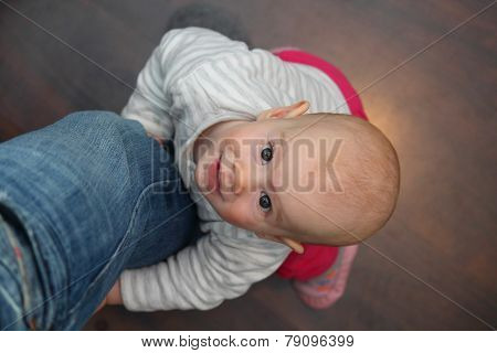 8 Month Old Baby Lifting Up On The Vathers Leg