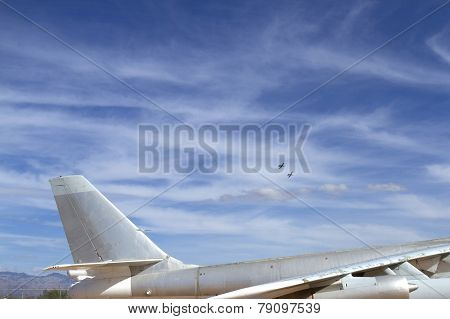 Fighter Jets In Formation Over Antique Plane