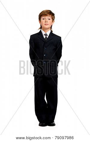 Full length portrait of a boy in a formal suit. Education. Copy space. Isolated over white.