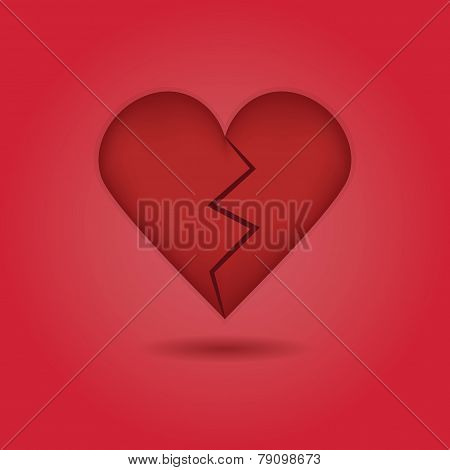 Red abstract broken heart icon with drop shadow on red gradient background