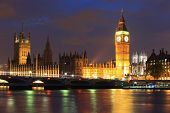 image of london night  - Big Ben and Houses of Parliament with blur ships on thames river at night London United Kingdom UK - JPG