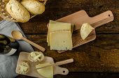 picture of cheese-steak  - Delicious ripe cheese with crispy baguette and wine wood board - JPG