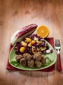foto of chicory  - meatball with red chicory and orange salad - JPG