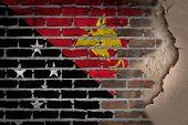 stock photo of papua new guinea  - Dark brick wall texture with plaster  - JPG