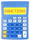 foto of macroeconomics  - Calculator with SANCTIONS on display isolated on white background - JPG