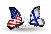 picture of flux  - Two butterflies with flags on wings as symbol of relations USA and Finland - JPG