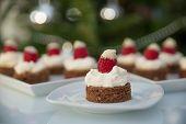 foto of brownie  - Santa hat brownie bites with chocolate brownie and raspberries - JPG