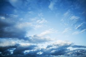 stock photo of blue  - Dark blue sky with clouds abstract nature background - JPG