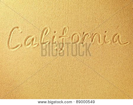 The word California is written on a sand background
