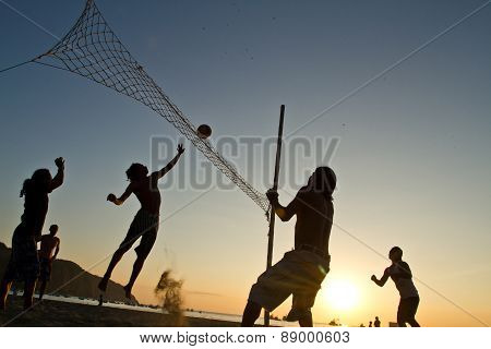 Beach volleyball silhouettes at a beach in Manabi, Ecuador