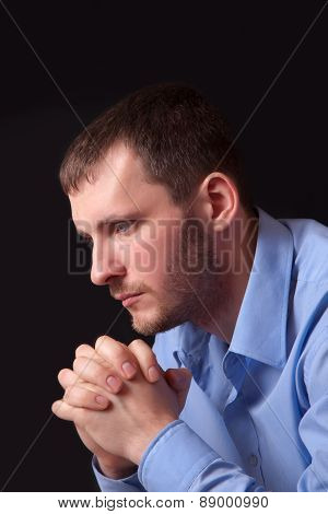 Thoughtful Young Man In Blue Shirt