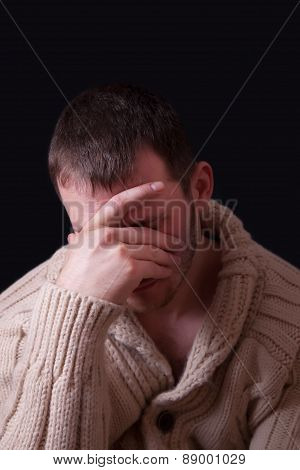Upset Man Covers His Face With A Hand