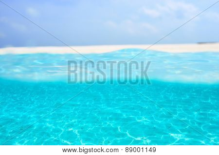 A white sand bottom in clear water at Maldives