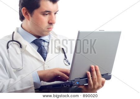 Hospital Doctor Working On A Laptop
