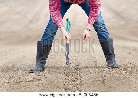 Shovel In Farmers Hands