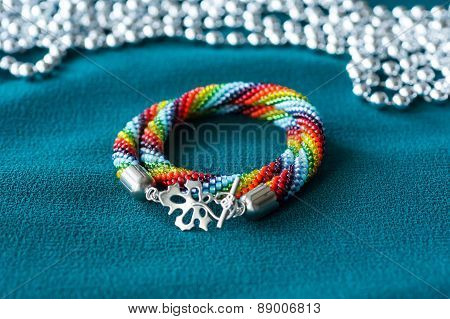 Handmade Multi-colored Necklace On A Green Textile Background