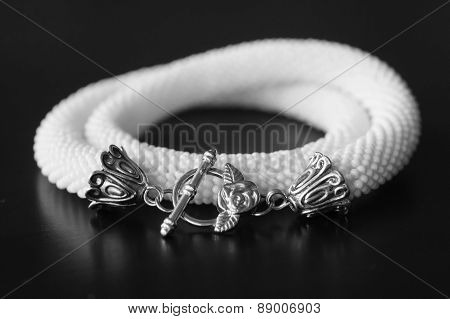 White Necklace Against A Dark Background, Black-and-white