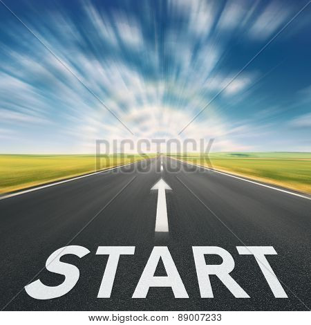 Empty Asphalt Road With A Sign Start In Blurred Motion