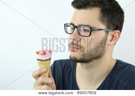 young man looking an ice cream