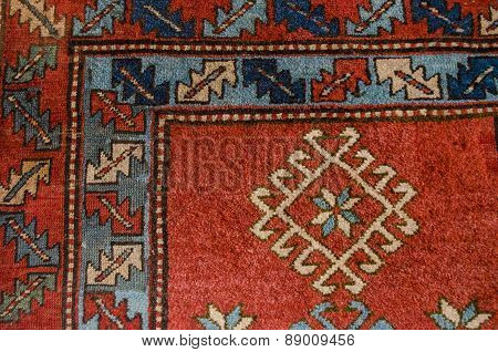 Angle ancient red woolen carpet