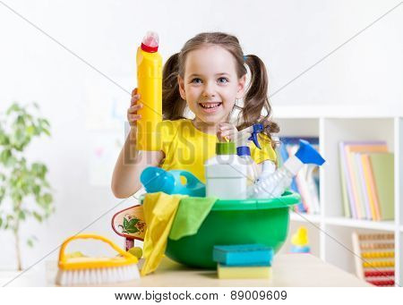 Cute child girl cleanses a floor