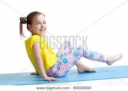 child doing fitness exercises