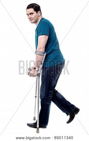 Injured Man With Crutches.