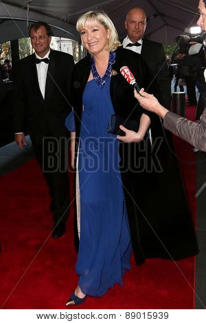 NEW YORK-APR 21: French politician & president of Front National Marine Le Pen (C) attends the 2015 Time 100 Gala at Frederick P. Rose Hall, Jazz at Lincoln Center on April 21, 2015 in New York City.