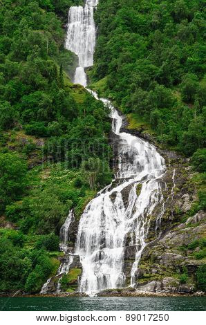 Tall Norwegian Waterfall Inflowing Into Geiranger Fjord