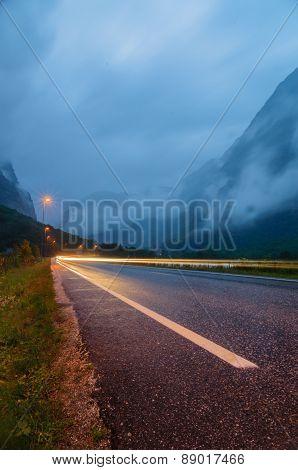 Long Exposure Car Light And Wet Asphalt Road
