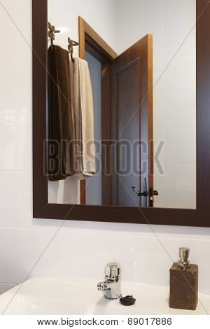 Mirror And Towels Detail In A Bathroom With White Walls