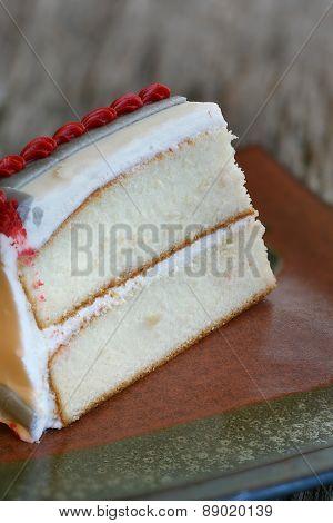 Piece of white vanilla cake close-up