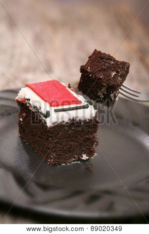 Piece of chocolate cake close-up