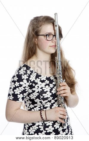Teenage Girl Stands Pensive With Flute
