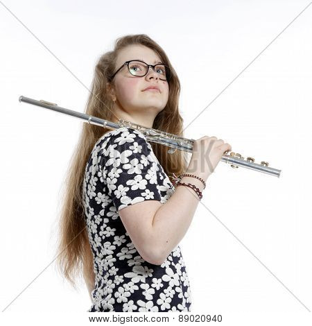 Blond Teenage Girl With Glasses Holds Flute In Studio