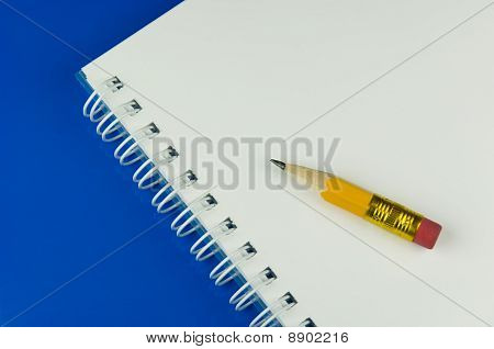 Notepad on blue ground