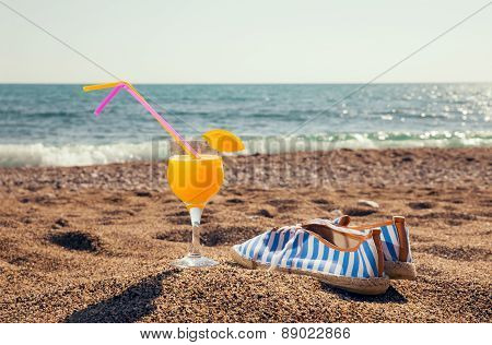 Cocktails and shoes for the beach for the beach on beach background