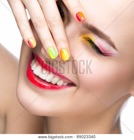 Beautiful model girl with bright colored makeup and nail polish in the summer image. Beauty face.