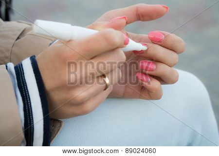 Girl Caring For Cuticles For A Walk