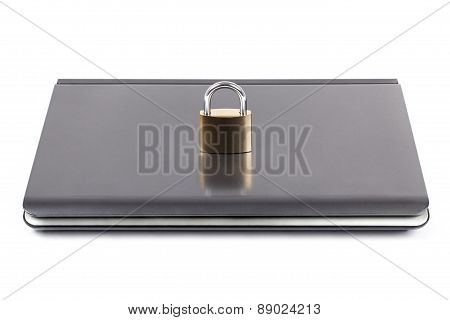 Computer And Padlock On Its Cover