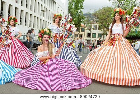 FUNCHAL MADEIRA - APRIL 20 2015: Performers with colorful and elaborate costumes taking part in the