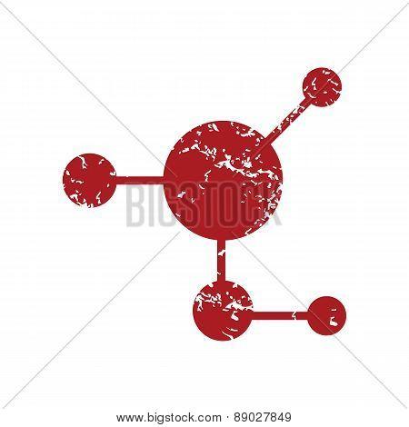 Red grunge atom logo