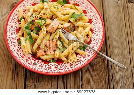 Creamy Pasta With Salmon And Parsley In Red Plate, Copyspace
